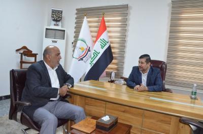 الاجودي يلتقي المدقق الدولي عوني حميد العبادي