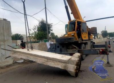 رفع الكتل الكونكريتية عن محيط هيئة التقاعد وسط بغداد
